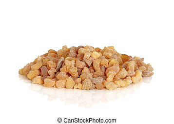 Frankincense olibanum resin isolated over white, background with reflection.