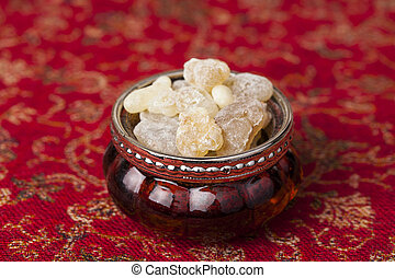 Frankincense is an aromatic resin, used for religious rites,...