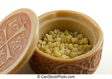 frankincense - Frankincense in a stone box isolated over...