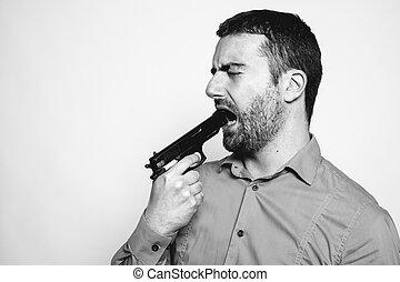 Frantic man shooting himself with a gun