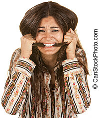 Frantic young woman biting on her long hair