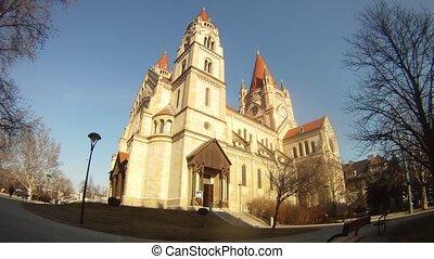 Franz von Assizi Church in Vienna stands against background of sky