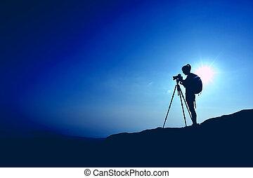 frau, fotograf, aufnahme nehmend