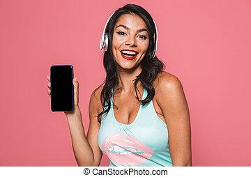 frau, in, bademode, ausstellung, textanzeige, von, handy, zuhören, musik, mit, headphones.