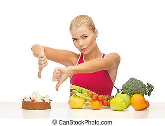 frau, mit, früchte, ausstellung, daumen hinunter, zu, kuchen