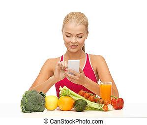 frau, mit, früchte, gemuese, und, smartphone