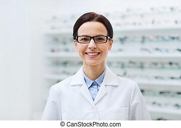 frau, optiker, in, brille, und, mantel, an, optik, kaufmannsladen