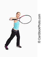 frau, spielen tennis, mit, a, schläger