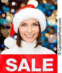 frau, verkauf zeichen, nikolausmuetze, weihnachten, glücklich