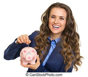 frauenunternehmen, setzen, schweinchen, lächeln, spaardose