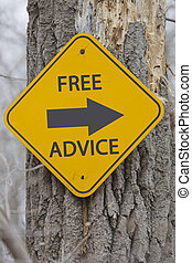 Free Advice Arrow Sign on Tree making a great concept.