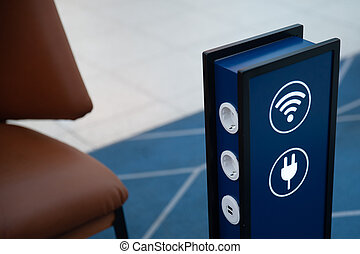 Free battery charging and free wi-fi station in a public place