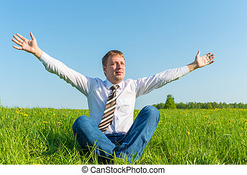 Free businessman enjoys independence in nature