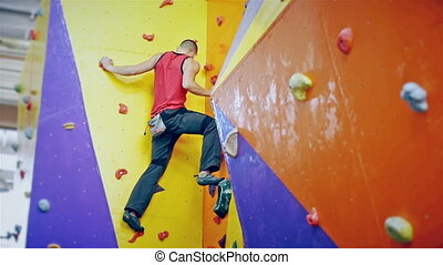 Free Climber Man Climbing On Practice Wall Indoors