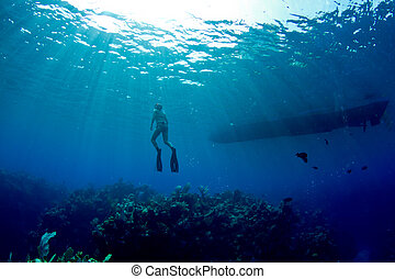 free diver and boat