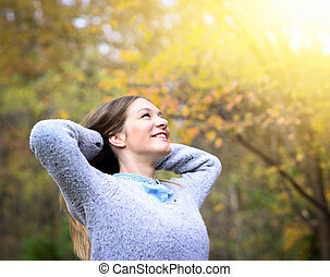 Free happy woman enjoying nature