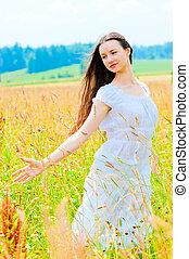 free happy woman in a Russian field