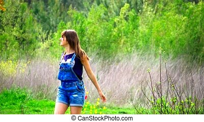 Free happy woman spinning arms outstretched enjoying nature...