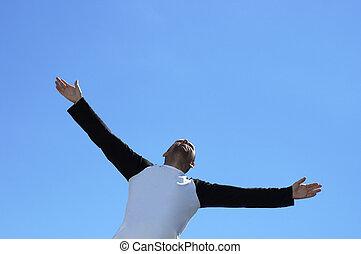 Free man - happy free man on the sky background