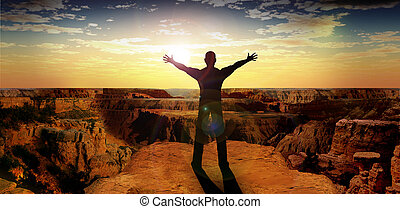man standing in the sunset with open arms