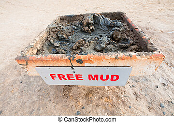 free mud on coast of Dead Sea - stand with free mineral mud...