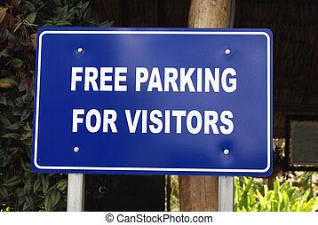 Free parking for visitors sign - parking is free for...
