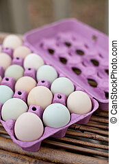 Free Range Organic Eggs - Open crate of colorful organic ...