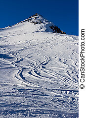 free-ride ski traces on the glacier in the Alps