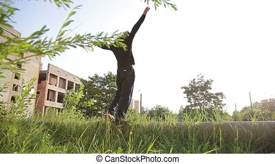 Free runner does front flip on the nature in full HD