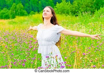 Free Russian young girl in a field with flowers