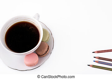 Free space for text, marketing and business information. Cake macaron and cap of coffee on a white background.