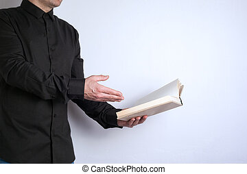 Free space for text, marketing education and business information. Man with a book on white background