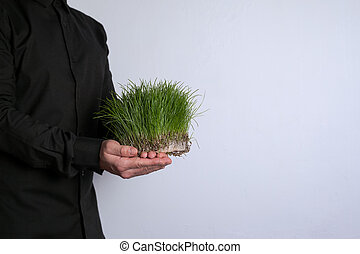 Free space for text, marketing education and business information. Man with a green grass on white background