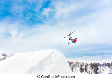 Free style skier. - Free style skier performing a high up in...