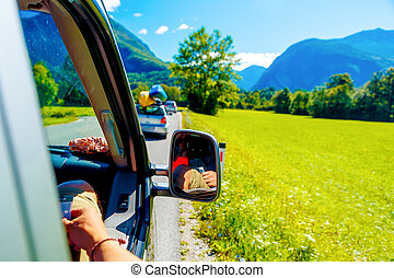 free summer car travelling road trip in beautiful mountain landscape