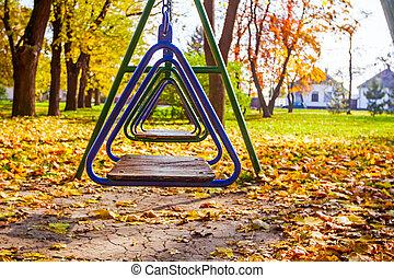 Free swings in sunny autumn