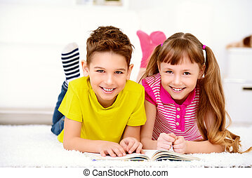 free time activity - Two happy kids spending time at home,...