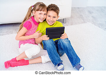 free time activity - Two cheerful laughing children spending...
