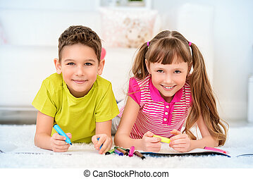 free time activity - Two happy kids spending time at home, ...