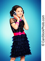 free time - Funny cheerful girl listens to music on ...