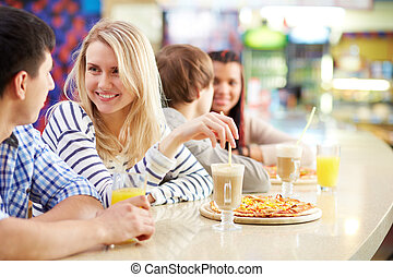 Free time - Image of teenage couple interacting in cafe