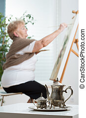 Older active woman creating an image in her free time