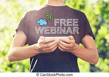 Free Webinar concept with young man holding his smartphone...