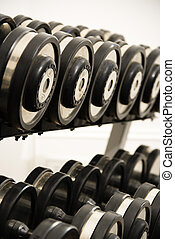 Free weights - Rack of hand weights on rack.