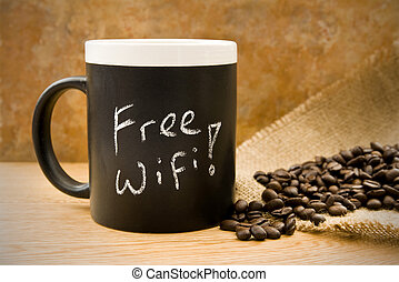 free wifi, coffee mug with coffee beans & hessian on counter