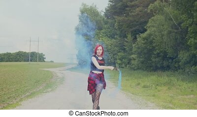 Free woman dancing with smoke bomb on country road - Happy...