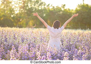Freedom And Healthy a girl stretching her arms in the sun among the butterflies