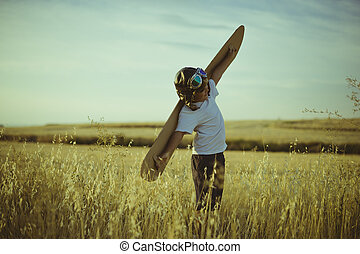 Freedom, Boy playing to be airplane pilot, funny guy with...
