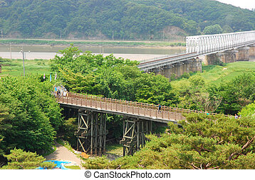 "The Bridge of Freedom got its name when 13,000 war prisoners shouted ""Hurray Freedom!"" as they returned home crossing the bridge following the Armistice Agreement in 1953. The bridge was blocked at the end where you can see the train that runs up to Dorasan Station from North Korea."
