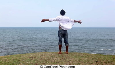 Freedom - Carefree man enjoying at the beach, freedom...